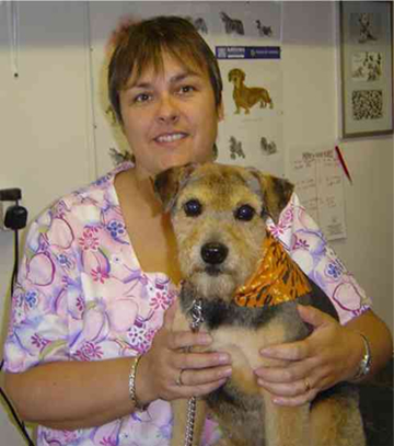 Nicki the groomer with one of her pampered pooches